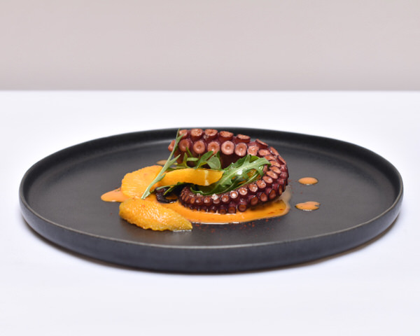 Octopus a la plancha, Orange and Sobrasada Vinaigrette, Rocket and Smoked Paprika