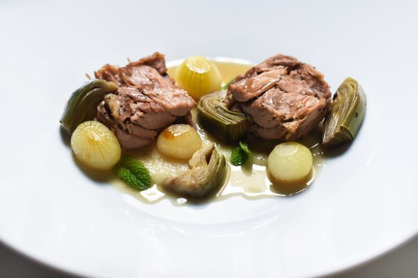 Slow Roasted Mallorca Lamb Shoulder served on a Sweet Onions Purée, Caramelized Baby Onions and Artichokes
