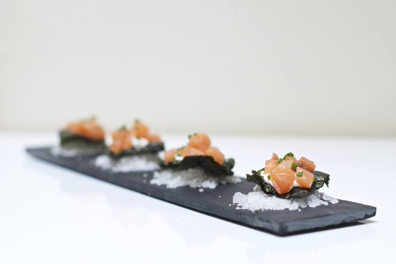Nori Chips, Aioli, Smoked Salmond and Chive Canapes served on a bed of Salt